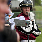 Female jockey Casey Lunn waits in the mounting yard during a day at the Races at the Gore Race Meeting, Gore, Southland, New Zealand. 18th December 2011. Photo Tim Clayton