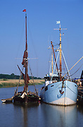 AT5BRD Sailing barge and boat moored quayside Snape maltings Suffolk England