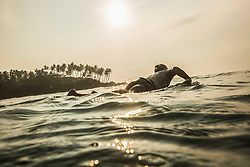 Silhouette of man surfboarding in the Indian ocean, Sri Lanka