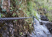 Steel cables assist hikers on the more treacherous parts of the HuaynaPicchu trail.