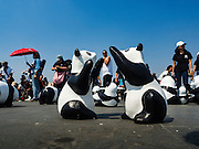 "04 MARCH 2016 - BANGKOK, THAILAND: People walk around paper maché pandas at the  opening of the ""1600 Pandas+ World Tour in Thailand: For the World We Live In and the Ones We Love"" exhibit in Bangkok. The 1600 paper maché pandas, an art installation by French artist Paulo Grangeon will travel across Bangkok and parts of central Thailand for the next week and then will be displayed at Central Embassy, a Bangkok shopping mall, until April 10. The display of pandas in Thailand is benefitting World Wide Fund for Nature - Thailand and is sponsored by Central Embassy with assistance from the Tourism Authority of Thailand and Bangkok Metropolitan Administration and curated by AllRightsReserved Ltd.     PHOTO BY JACK KURTZ"