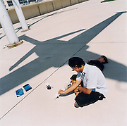 Young people play with supersonic Air France Concorde models beneath the shadow of a fighter jet at the Le Bourget airport, days after the crash at nearby Gonesse which ended the life of the Concorde airliner.