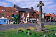 AE2KR6 Village green war memorial shops Burnham Market Norfolk England