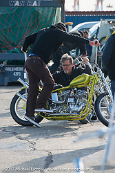 Jokers Skate Shop's Joe Keravan with his custom 1938 Harley-Davidson Flathead at the docks where it was picked up with all of the invited builder's bikes for the Mooneyes show. Yokohama, Japan. Saturday December 2, 2017. Photography ©2017 Michael Lichter.