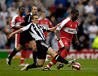 Photo: Jed Wee.<br /> Middlesbrough v Newcastle United. The Barclays Premiership. 22/10/2006.<br /> <br /> Newcastle's Scott Parker (L) tries to tackle Middlesbrough's Yakubu.