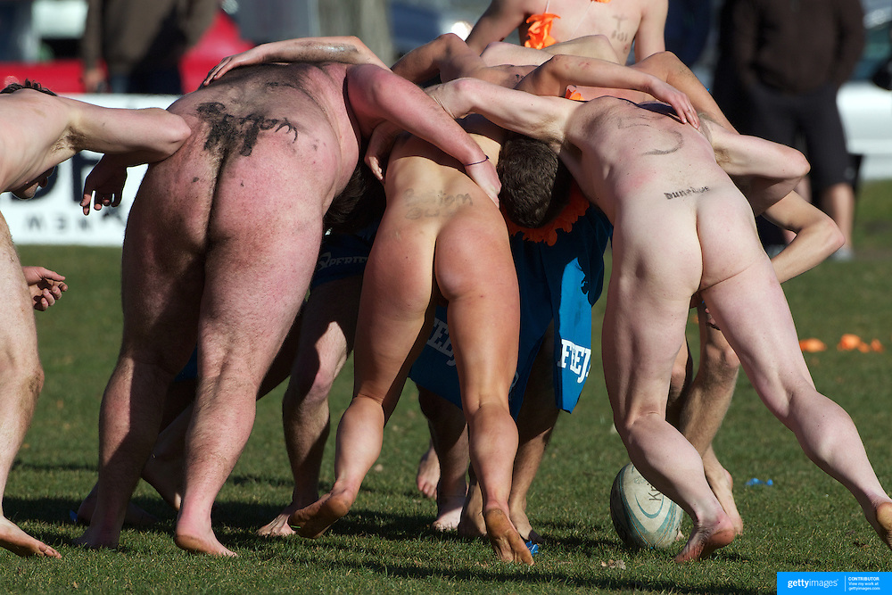 A scrum is contested during the 'Nude Blacks' versus a Fijian invitation side played at Logan Park, Dunedin as an unofficial curtain raiser match before the New Zealand V Fiji test match in Dunedin, New Zealand...The 'Nude Blacks' won the match 20-10 with 21 year old female player Rachel Scott, a member of the Otago women's rugby team named player of the day. .Over 500 people turned up to watch the match which included a blind referee, Julie Woods and three clothed streakers who were ejected from the playing area..The 'Nude Blacks' traditionally play games before test matches in Dunedin and were using this match as a warm up for three nude games planned during the IRB Rugby World Cup in New Zealand with teams from Argentina, Italy, England and Ireland involved.  Matches will be played before World Cup games in Dunedin. New Zealand. 22nd July 2011. Photo Tim Clayton
