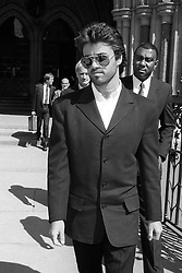 Pop superstar George Michael in London after he accepted a six-figure undisclosed libel damages in the High Court against The Sun newspaper over stories that he gatecrashed a party being given by Andrew Lloyd Webber and was drunk and abusive.