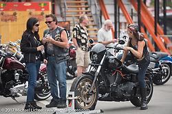 Checking out the new 2017 bikes at the Harley-Davidson display at Daytona Speedway during Daytona Bike Week. Daytona Beach, FL. USA. Monday March 13, 2017. Photography ©2017 Michael Lichter.