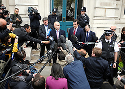 Liberal Democrat and Conservative senior politicians after holding 8 hr talks on forming Government at the Cabinet Rooms in Whitehall today...The Lib Dem team comprises home affairs spokesman Chris Huhne, Nick Clegg's chief of staff Danny Alexander, children's spokesman David Laws and Andrew Stunell, the vice chairman of the campaign team...Representatives from the Conservatives include Mr Hague, shadow chancellor George Osborne, senior MP Oliver Letwin and David Cameron's chief of staff Ed Llewellyn.