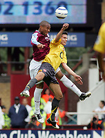 Photo: Paul Thomas.<br /> West Ham United v Arsenal. The Barclays Premiership. 24/09/2005.<br /> <br /> West Ham's Danny Gibbidon out jumps Robin Van Persie.
