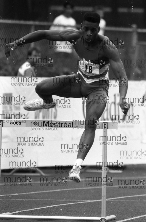 ******This is an unprocessed scan from the negative. You can buy it as is and clean it up yourself, or contact us for rates on providing the service for you. *******<br /> <br /> (Montreal, Canada---18-21 June 1992) Mark Jackson in the 400m hurdles at the 1992 Canada Track and Field Olympic Trials as the complexe sportif Claude-Robillard in Montreal. Photo 1992 Copyright Sean Burges / Mundo Sport Images.<br /> <br /> ******This is an unprocessed scan from the negative. You can buy it as is and clean it up yourself, or contact us for rates on providing the service for you. *******