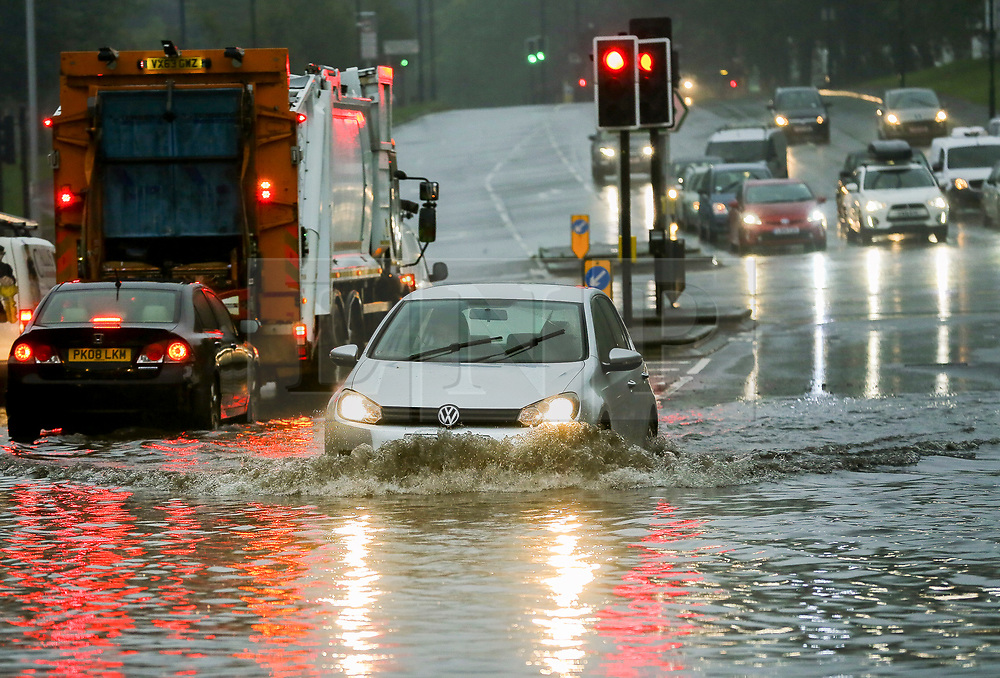 © Licensed to London News Pictures. 03/10/2020. London, UK. Cars drive through a flood in north London caused by Storm Alex. The Met Office forecasts heavy rain and windy weather for the rest of the day in the capital. Photo credit: Dinendra Haria/LNP