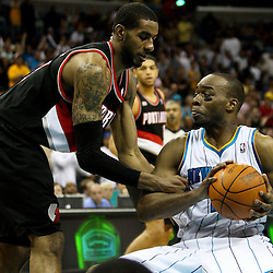 March 30, 2011; New Orleans, LA, USA; New Orleans Hornets power forward Carl Landry (24) is fouled by Portland Trail Blazers power forward LaMarcus Aldridge (12) in the final seconds of the fourth quarter at the New Orleans Arena. The Hornets defeated the Trail Blazers 95-91.   Mandatory Credit: Derick E. Hingle