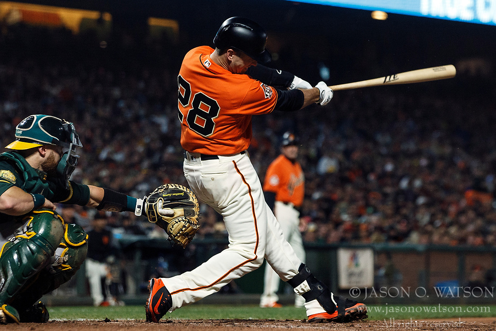 SAN FRANCISCO, CA - JULY 13: Buster Posey #28 of the San Francisco Giants hits an RBI single against the Oakland Athletics during the sixth inning at AT&T Park on July 13, 2018 in San Francisco, California. The San Francisco Giants defeated the Oakland Athletics 7-1. (Photo by Jason O. Watson/Getty Images) *** Local Caption *** Buster Posey