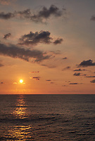 Orange colored sky and clouds over the Pacific Ocean just after sunrise. Image 8 of 10 for a wide-angle panorama taken with a Fuji X-T1 camera and 35 mm f/1.4 lens  (ISO 200, 35 mm, f/16, 1/250 sec). Raw images processed with Capture One Pro and stitched together with AutoPano Giga Pro.
