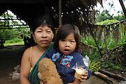 Ecuador, May 6 2010: A Huaorani mother and daughter pose for the camera. Copyright 2010 Peter Horrell