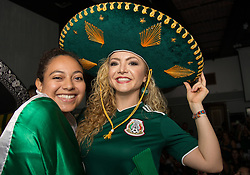 July 2, 2018 - FL, USA - Mexico fans Berenice Rivera, left, and Ingrid Osorio celebrate Mexico during a FIFA World Cup Round of 16 knockout stage watch party featuring Brazil versus Mexico at Vares in Brickell on Monday, July 2, 2018. (Credit Image: © Sam Navarro/TNS via ZUMA Wire)