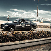 Policia Federal in convoy on one of Puerta Vallarta's main shopping areas