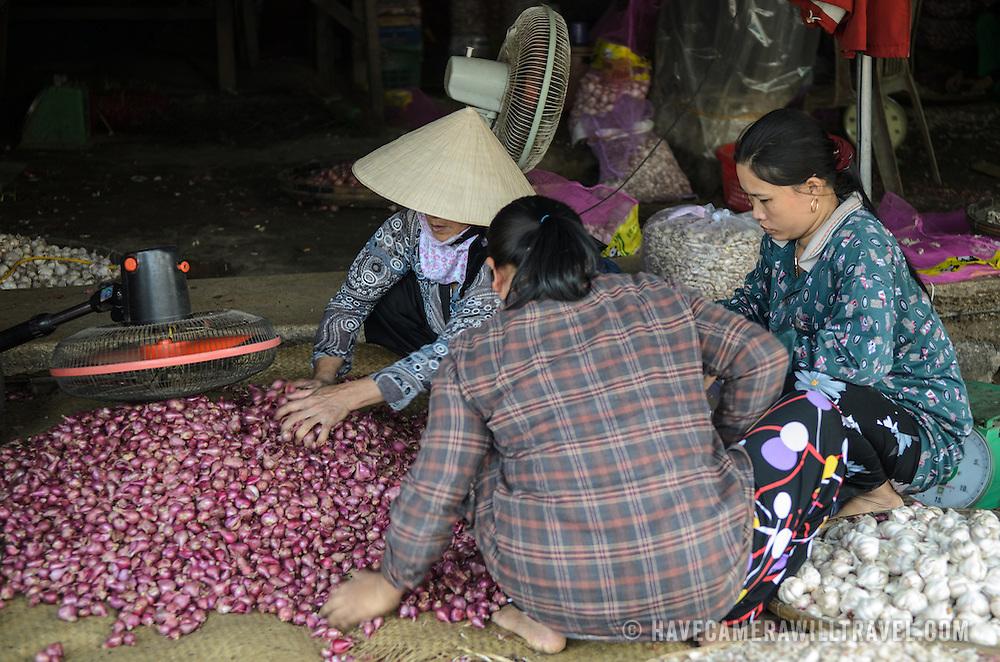 Shallots and garlic for sale at Cho Dong Ba, the main city market in Hue, Vietnam.