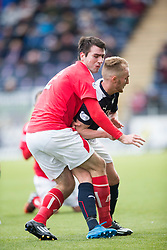 Brechin City's Paul McLean tackled by Falkirk's Craig Sibbald. <br /> Falkirk 2 v 1 Brechin City, Scottish Cup fifth round game played today at The Falkirk Stadium.