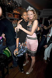 Left to right, TOLULA ADEYEMI and OLIVIA INGE at a party to celebrate the opening of Barts, Sloane Ave, London on 26th February 2009.