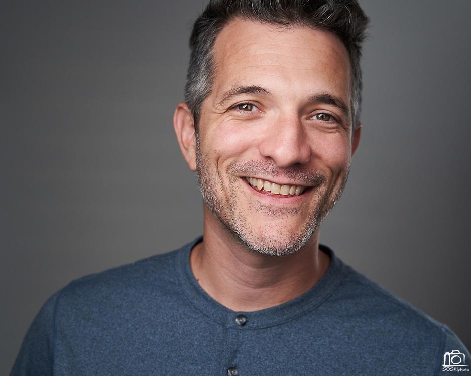 Photographer Drew Bird poses for a headshot at SOSKIphoto in Hayward, California, on October 22, 2020. (Stan Olszewski/SOSKIphoto)