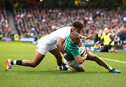 Simon Zebo of Ireland is tackled by Anthony Watson of England - Mandatory by-line: Ken Sutton/JMP - 18/03/2017 - RUGBY - Aviva Stadium - Dublin,  - Ireland v England - RBS 6 Nations