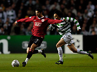 Photo: Jed Wee.<br /> Glasgow Celtic v Manchester United. UEFA Champions League, Group F. 21/11/2006.<br /> <br /> Manchester United's Cristiano Ronaldo (L) takes on Celtic's Shunsuke Nakamura.
