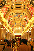 Visitors walk the main corridor at the Venetian casino in Macau, China, on February 21, 2008. The Venetian Macao-Resort-Hotel is a 163,000 square foot casino featuring 405 slots and 277 table games. Macao has overtaken Las Vegas with a gambling revenue of 7 billion U.S. dollars in 2006 (Las Vegas' was 6.6 billion U.S. dollars), and is now the world's top casino hut. Photo by Lucas Schifres/Pictobank