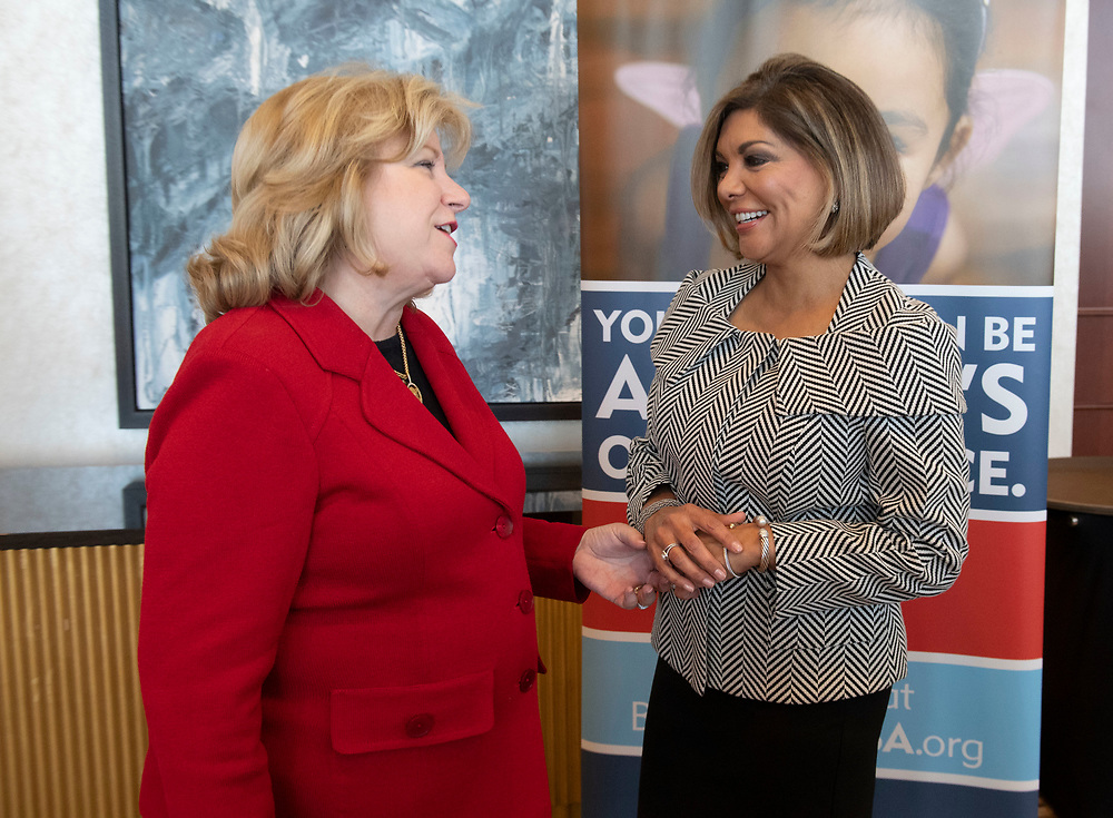 Texas Supreme Court Justice Eva Guzman, left, with Sen. Jane Nelson,  receives an award from the Texas CASA (Court Appointed Special Advocates) for her support of the organization on April 6, 2017. Guzman, the first Hispanic woman to serve on the Texas Supreme Court, resigned her position and is rumored to be considering a challenge to Attorney General Ken Paxton.