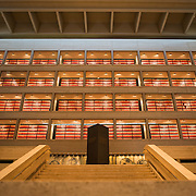 A central internal atrium at the LBJ Library displaying the spines of red archival boxes through glass windows. The LBJ Library and Museum (LBJ Presidnetial Library) is one of the 13 presidential libraries administered by the National Archives and Records Administration. It houses historical documents from Lyndon Johnson's presidency and political life as well as a museum.