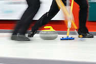 A rock and brooms down ice in a blur of movement at the 2011 GP Car and Home Players' Championship April 13 at the Crystal Centre, Grande Prairie, AB..11-04-13, Photo Randy Vanderveen, Grande Prairie, Alberta.