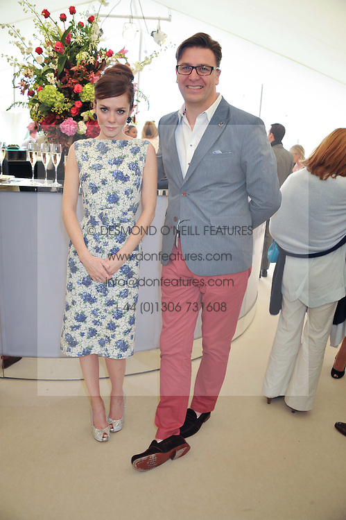 ANNA FRIEL and PAUL JAMES Global Brand Leader for St. Regis Hotels & Resorts at the St.Regis International Polo Cup between England and South America held at Cowdray Park, West Sussex on 18th May 2013.  South America won by 11 goals to 9 goals.