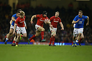 Leigh Halfpenny of Wales © makes a break. Wales v Italy , NatWest 6 nations 2018 championship match at the Principality Stadium in Cardiff , South Wales on Sunday 11th March 2018. pic by Andrew Orchard, Andrew Orchard sports photography