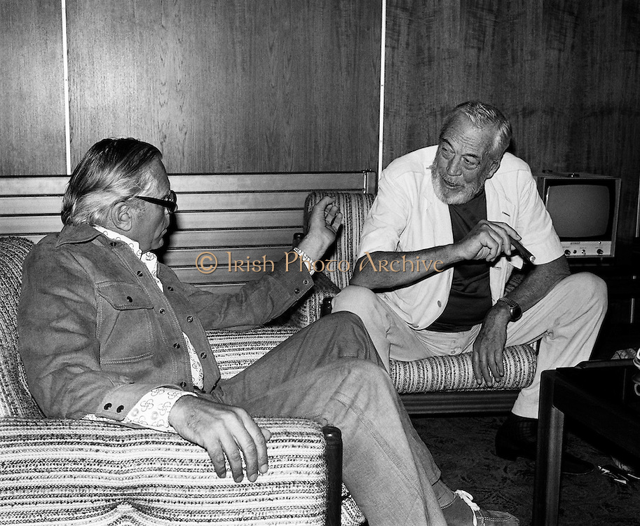 Renowned film director John Huston (right) flies in from Mexico to take part in 'Circasia 75' at Straffan House, Co Kildare, where he is to play the part of ringmaster. He is pictured with Kevin McClory, organiser of the event.<br /> 13/09/1975