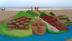 June 4, 2017 - Bhubaneswar, Orissa, India - Visitors look near to sand sculpture creating by local sand artists on the eve of World Environment Day at the Bay of Bengal Sea's eastern coast beach at Puri outskirts of the eastern Indian state Odisha's capital city Bhubaneswar. (Credit Image: © Str/NurPhoto via ZUMA Press)