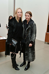 Left to right, GEMMA EBELIS and SOPHIE McELLIGOTT at a private view of Refraction. The Image of Sense held at Blain Southern, Hanover Square, London on 9th December 2014.
