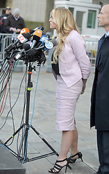 Adult-film star Stormy Daniels who is entangled in a legal fight with U.S. President Donald Trump's longtime personal lawyer Michael Cohen along with lawyer, Michael Avenatti delivers a short statement when she exits a hearing in New York City, NY, USA on April 16, 2018. U.S. President Donald Trump's longtime personal lawyer Michael Cohen also arrived at Manhattan Federal Court on Monday for a showdown over documents seized as part of a federal investigation that could cast a harsh light on Trump's business and personal relationships. Photo by Dennis Van Tine/ABCACAPRESS.COM