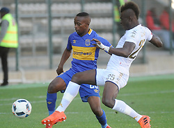 Cape Town-180224 Cape Town CityThabo Nodada challenging for a ball as WIts player Edwin Gyimah defending in their PSL game in Athlone Picture Ayanda Ndamane/African News Agency/ANA