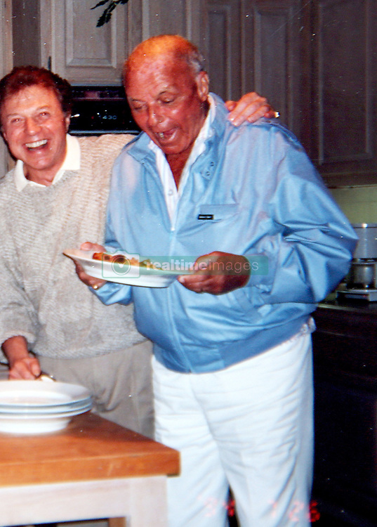 EXCLUSIVE: Dick Martin's wife Dolly Read opens her home and lifts the lid on the love affair the couple enjoyed and how their showbiz parties were the talk of Tinseltown in the 1970's. The very first British Playboy Playmate, who went on to be a cult film superstar in Beyond The Valley Of The Dolls, found fame after dazzling Hugh Hefner with her bombshell looks and was married to comedy legend Dick for 40 years. The couple often cooked meals and hosted parties for their closet friends including Frank and Nancy Sinatra, Sammy Davis Jr, Dean martin, Don Riccles and Dick Van Dyke. 13 Apr 2018 Pictured: Dinner party with close friend Frank Sinatra in 1994. Photo credit: MOVI Inc. / MEGA TheMegaAgency.com +1 888 505 6342