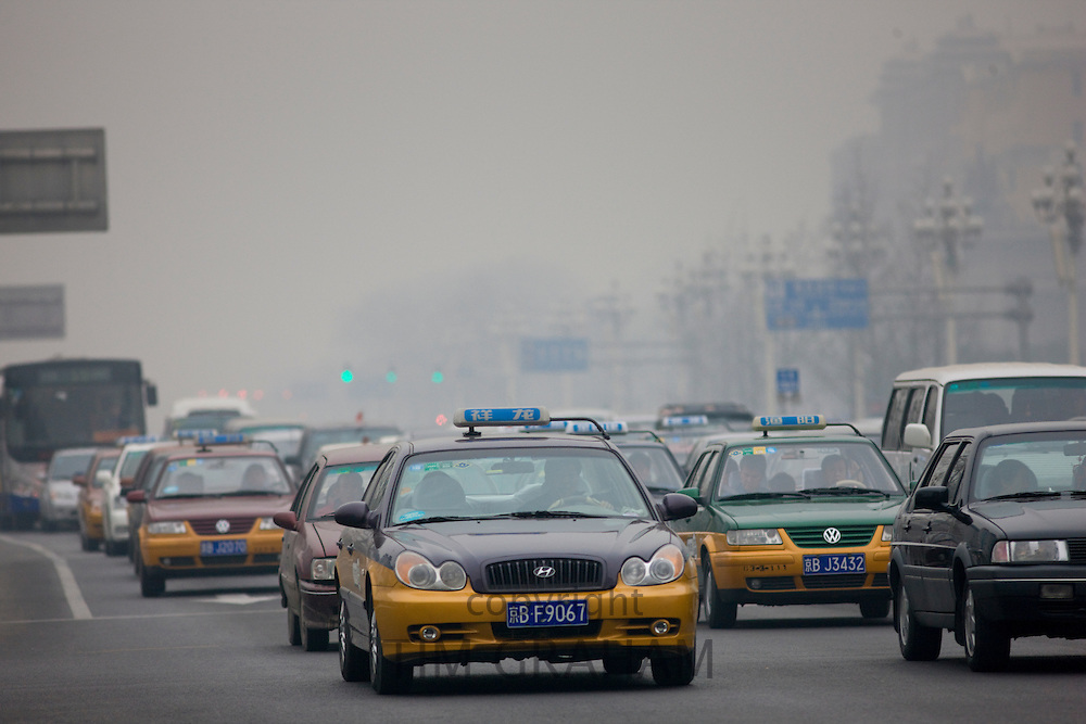 Taxis and traffic on Beijing main street, China