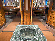 "15 MARCH 2020 - DES MOINES, IOWA: An empty holy water font in the vestibule of a Catholic church in Des Moines. The diocese of Des Moines announced that holy water fonts would be empty to prevent the spread of the Coronavirus. Most churches in the Des Moines area canceled their Sunday services or switched to an online service this week. Those churches that conducted Sunday services imposed ""social distancing"" guidelines, including no physical contact, and had significantly lower attendance. The Governor of Iowa announced Saturday night that the Coronavirus in Iowa had entered the ""community spread"" phase when a person in Dallas County, in the Des Moines metropolitan area, tested positive for Coronavirus. This is the first reported case in the Des Moines area. As of Sunday morning, Iowa was reporting 18 people tested positive for Coronavirus.          PHOTO BY JACK KURTZ"