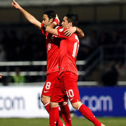 Turkey's Selcuk Inan (L) celebrate his goal with team mate during the FIFA World Cup 2014 qualification match Andorra betwen Turkey at the Andorra la Vella stadium in Andorra March 22, 2013. Photo by TURKPIX