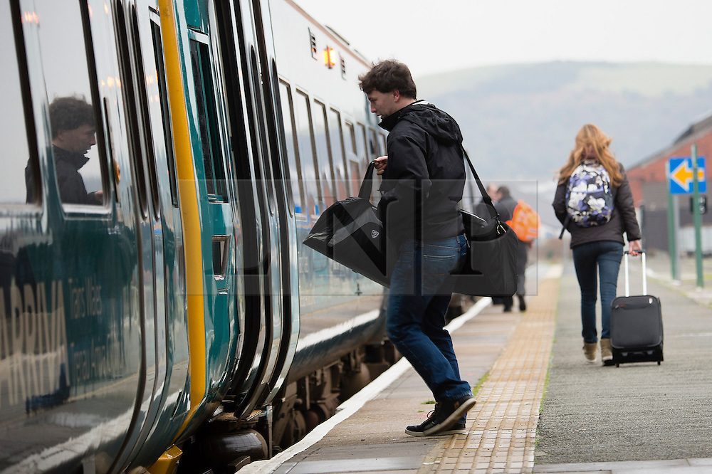 © London News Pictures. 31/01/2014. Aberystwyth, UK. Aberystwyth university students leaving town on Arriva Wales trains. The University authorities are planning to close their seafront halls of residence as a precautionary measure at 16.00 this afternoon in advance of forecast high winds and stormy seas. Of the 600 students living on the seafront, about 450 are in university-owned accommodation.  They are being offered alternative accommodation on the university campus, or financial help to return home for the weekend. The town of Aberystwyth suffered severe damage to it's seafront during recent storms which battered the West coast of the UK and Ireland. Photo credit: Keith Morris/LNP