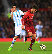 Angel Di Maria of Argentina tackles Andre Gomes of Portugal - Argentina vs. Portugal - International Friendly - Old Trafford - Manchester - 18/11/2014 Pic Philip Oldham/Sportimage