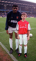 Kanu with the Arsenal mascot. Everton v Arsenal. FA Premiership 18/11/2000. Credit: Colorsport / Andrew Cowie.