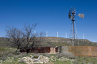 Aeromotor windmill in front of electric wind farms near McCamey, Texas.