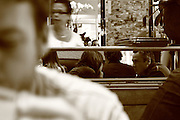 A couple talking in Max Café in the centre of Ghent are reflected in a mirror