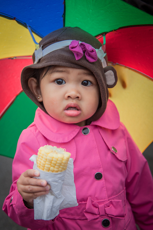 Child with corn on the cob at the Alaska State Fair, Palmer, Alaska