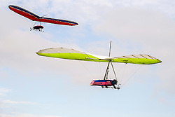 Hang gliders fly from the hills around Mam Tor in the Hope Valley <br />  11 October 2015<br />   Image © Paul David Drabble <br />   www.pauldaviddrabble.co.uk